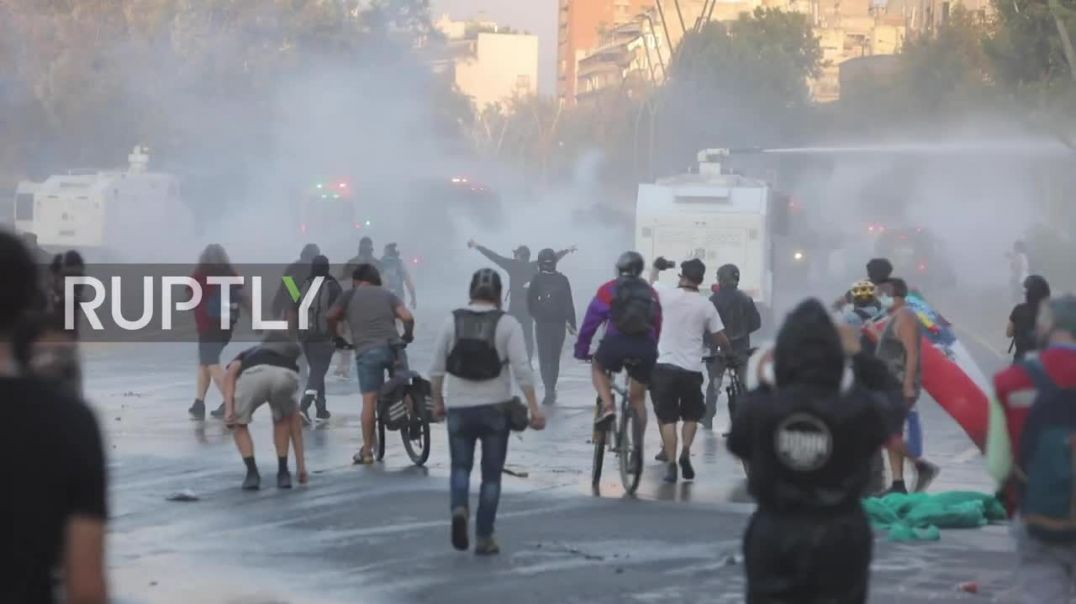 Chaos in Santiago, Chile as police fire water cannon at anti-government protesters